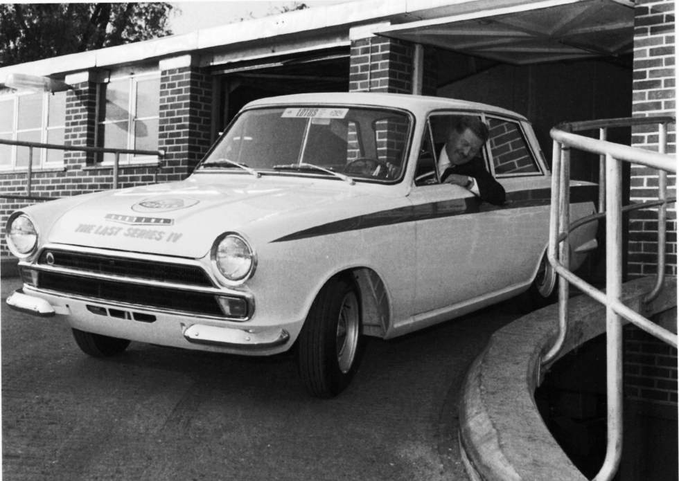 fred bushell taking the last left hand drive type iv lotus cortina down the ramp lotus were to move to hethel shortly after this photograph was taken